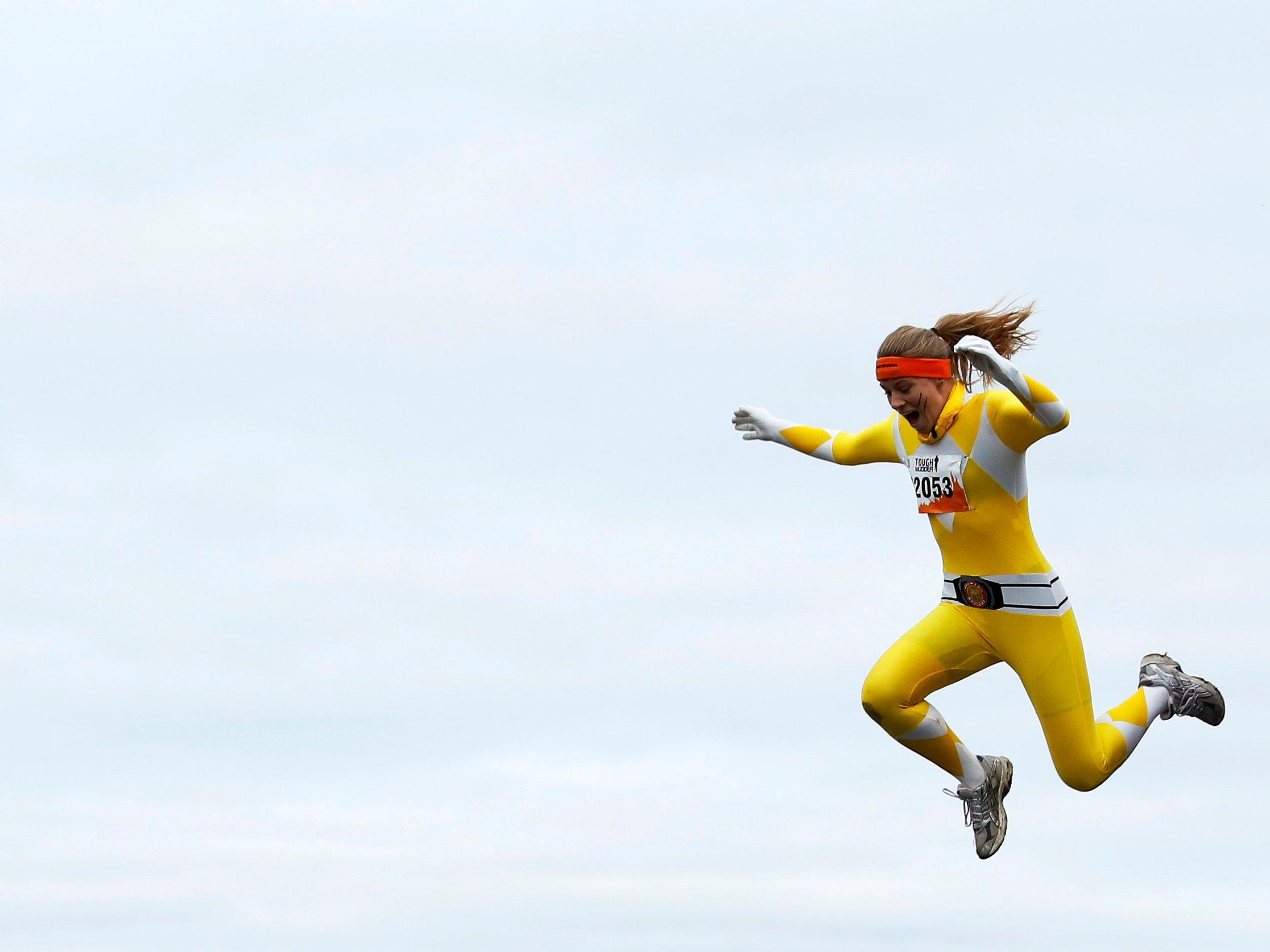woman-runner-running-jumping-tough-mudder-race